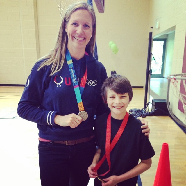 This cute kid got to meet a real #olympian and hold her #goldmedal @ the #ymca