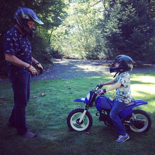 This is my fave pic from our dirt biking adventure the other day.  I love how Judah is giving his full attention to his motorcycle mentor even though he wants so badly to tear out of there.  Way to show some restraint buddy!